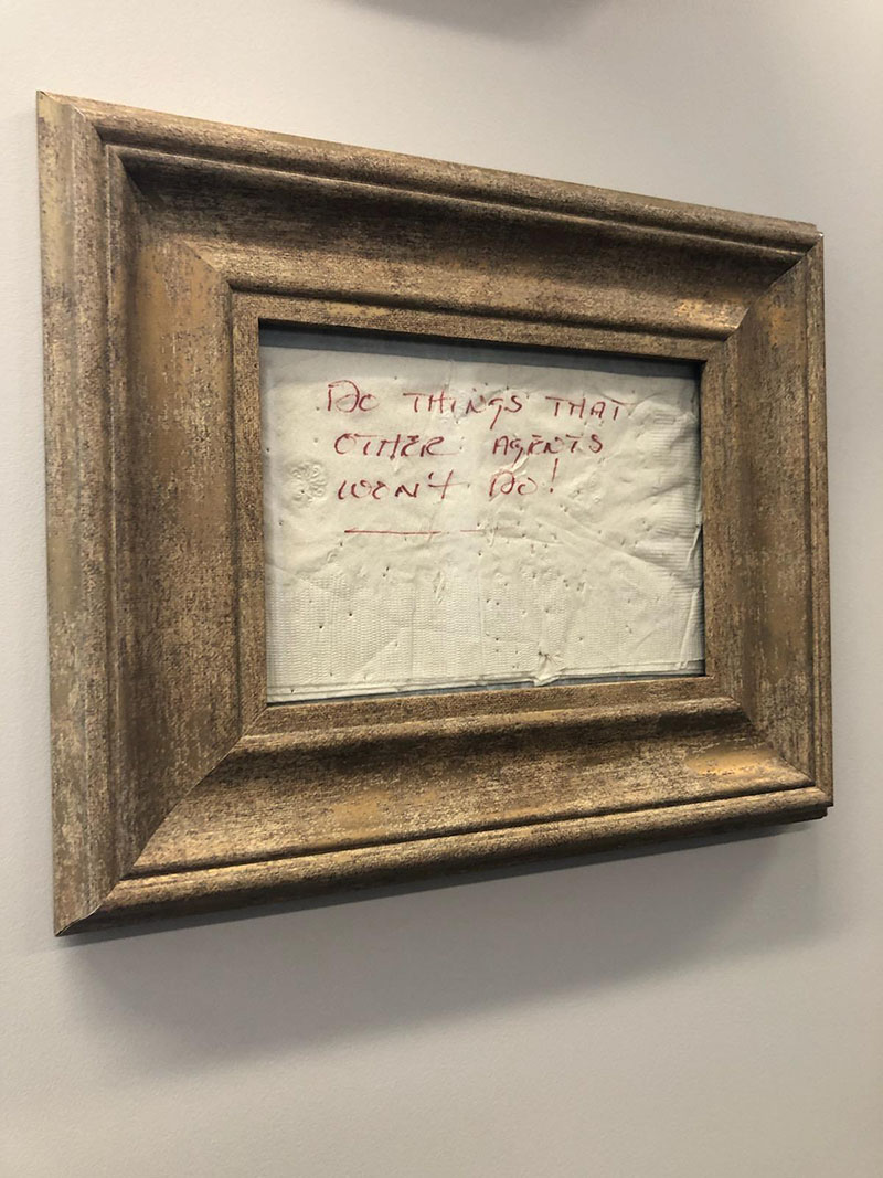 Framed napkin that hangs on the wall in Scott Bicknell's office - Do Things That Other Agents Won't Do!