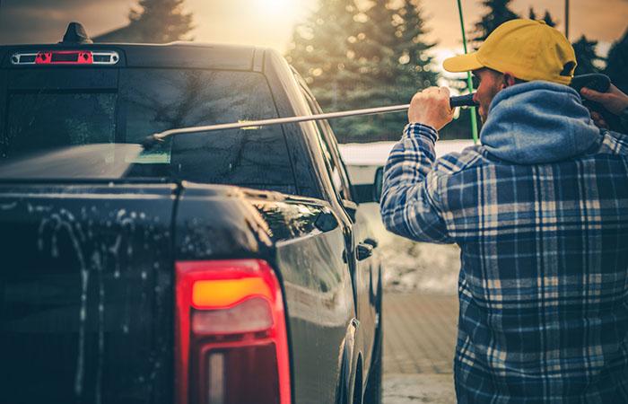 Caucasian Men Power Washing His Pickup Truck After